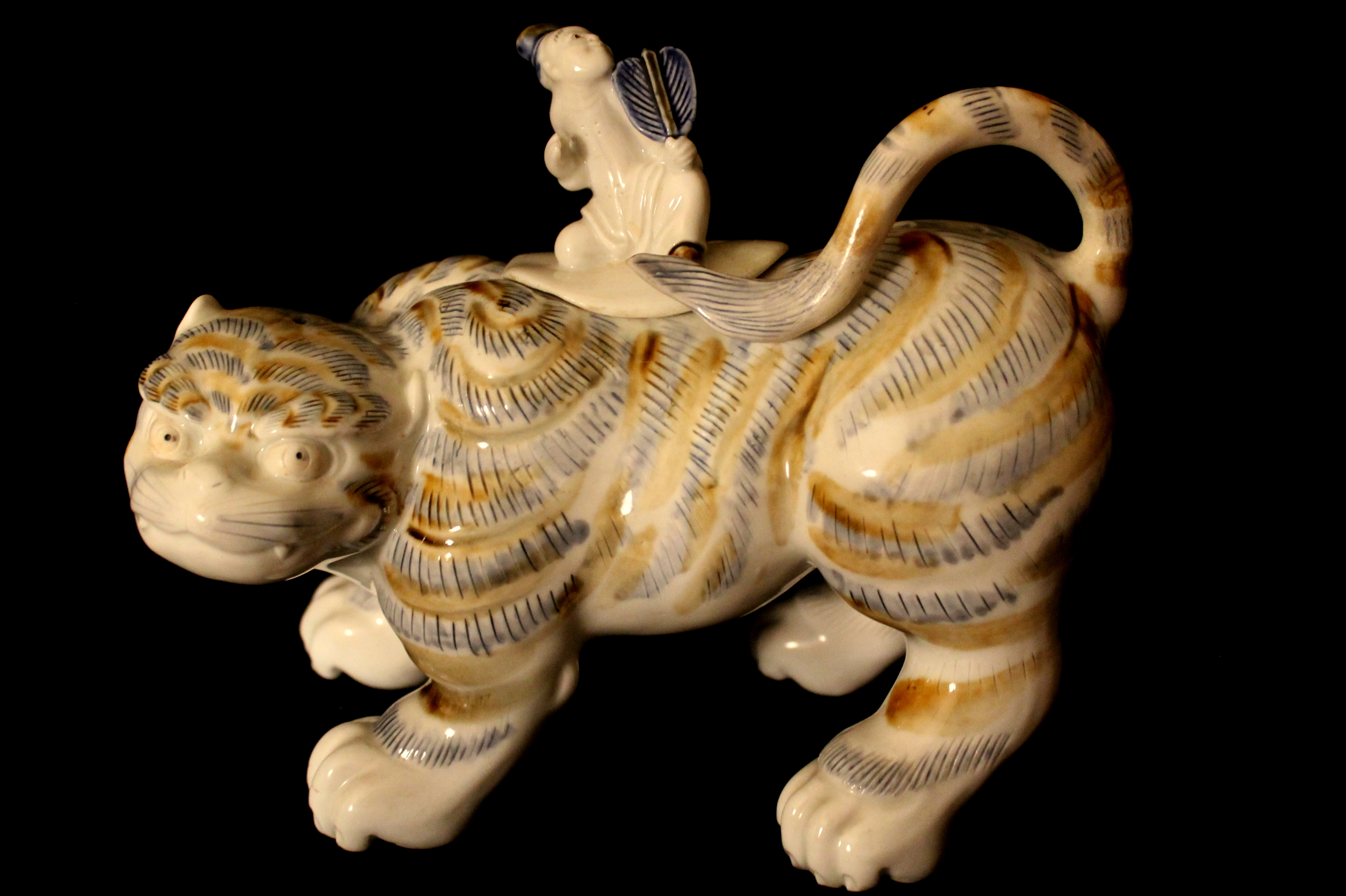 Hirado, Mikawachi ware porcelain censer in form of Tiger and cover modeled figurine with fan, brown and blue glazes , Japan