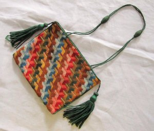 Purse embroidered in Berlin woolwork